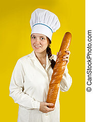 baker with French bread - female baker with French bread...