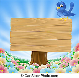 Bluebird sitting on wood sign with