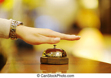 hotel reception - business woman at the reception of a hotel...