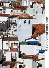 Town and church, Monda, Spain. - General view of townhouses...