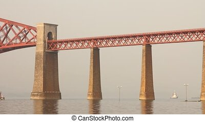 Train passing on the Forth bridge or Forth rail bridge near...