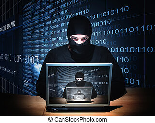 hacker on duty - portrait of caucasian hacker with balaclava