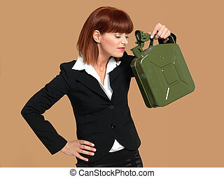 attractive, young businesswoman smelling gas canister -...