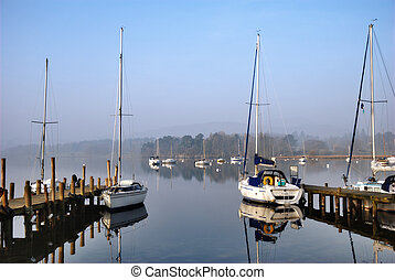 Scenic yacht moorings on a lake - Scenic view of yachts...
