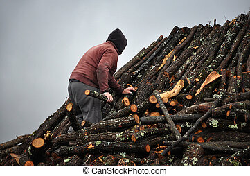Man working on a charcoal pile in Transylvania, Romania