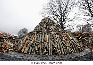 Charcoal pile in the outdoors, Transylvania, Romania