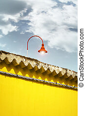 Yellow Wall and Red Streetlamp - Detail of an yellow wall...