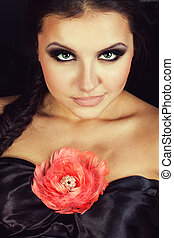 Young beautiful woman with rose