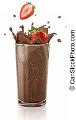 Strawberries splashing into a chocolate milkshake glass. -...