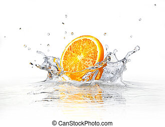 Orange slice falling and splashing into clear water On white...