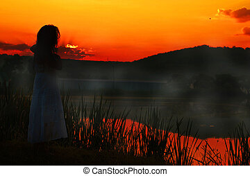 Girl in red sunset