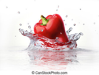 Red sweet bell pepper falling and splashing into clear water...