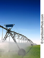 Crop Irrigation - A farm being irrigated with a center pivot...