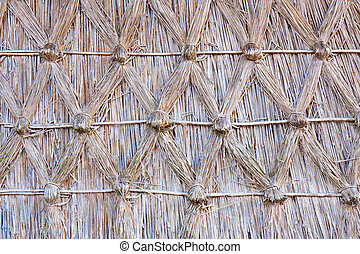 Wall of reed with a diamond-shaped pattern