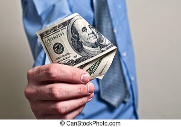 Businessman paying in dollars