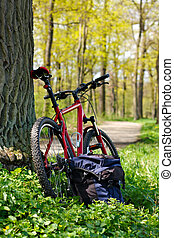 Bike and Backpack against the background of nature in spring...