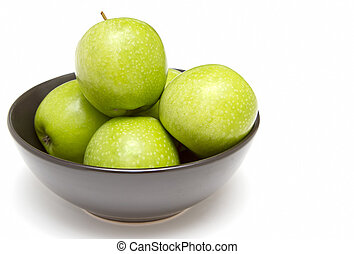 Black bowl of granny smith apples
