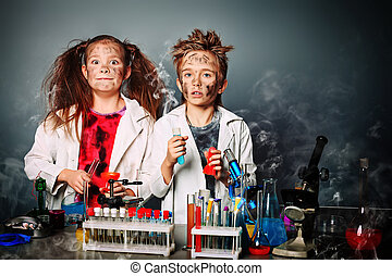 emotional bang - Two children making science experiments...