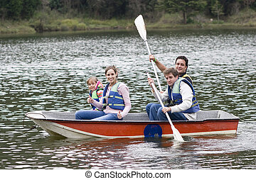 Happy Family, Uncle, Mother,Father and Daughter Canoeing on...