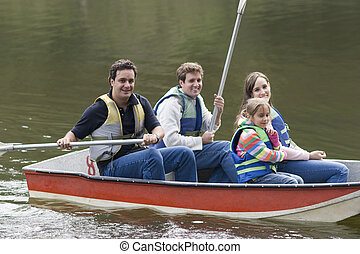 Happy Family Canoeing on Lake, Uncle, Mother,Father and...