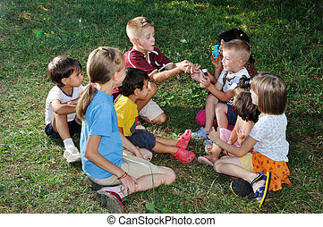 Kids blowing soap bubbles
