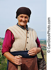 Portrait of a very old woman outdoors