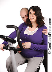 Pregnant woman on treadmill with her husband