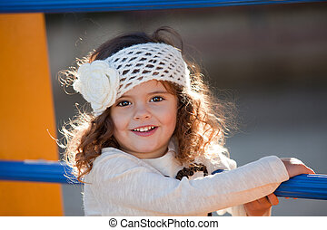 Happy smiling, child playing outdoors