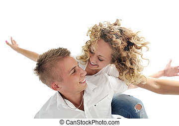 Portrait of a romantic young couple smiling together