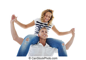 Portrait of handsome guy carrying his girlfriend  on shoulder against white background