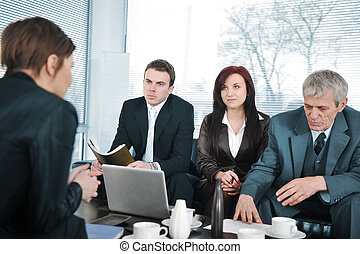 Businesswoman in an interview with three business people