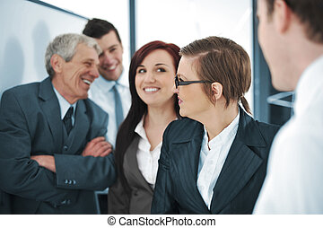 Business team discussing a project with boss