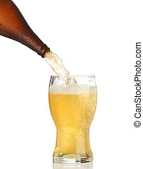 Pouring cold beer into glass isolated on white
