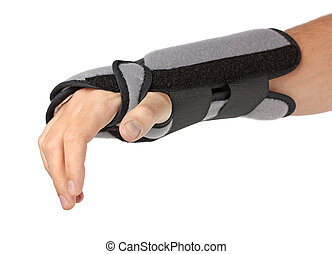 Human hand with a wrist brace, orthopeadic equipment over...