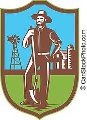 farmer standing leaning spade shovel - Illustration of a...