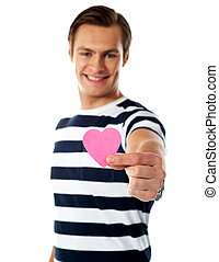 Young man offering paper heart - Young man ofering his paper...