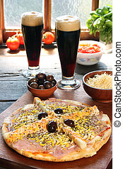 Palmetto pizza with two glasses of beer and ingredients