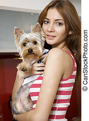 Cute young girl with her Yorkie puppy - Cute young brunette...