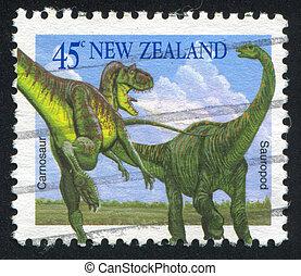Carnosaur and Sauropod - NEW ZEALAND - CIRCA 1993: stamp...