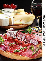 Salami and cheese platter with herbs
