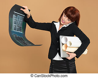 busy, young architect holding laptop, papers, telephone -...