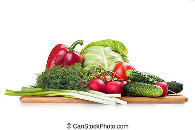 fresh vegetables on the board, on a white background