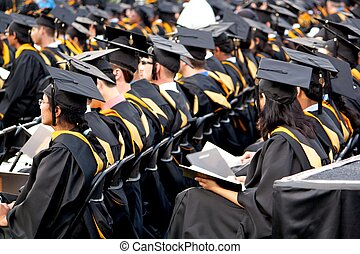 Graduates At Commencement Ceremony - Graduating students...