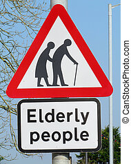 British elderly people crossing road warning sign.