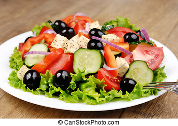 Greek salad on the white plate