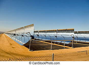 Alternative Energy - A row of solar mirrors in the Mojave...
