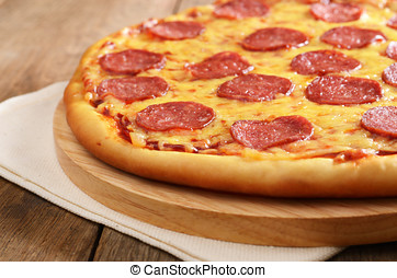 Pepperoni pizza  on the kitchen table