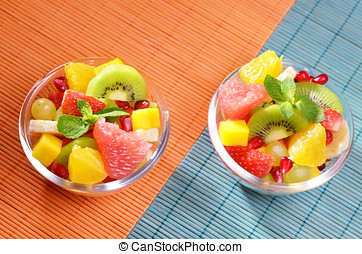 Fruit salad - Healthy fruit salad in the glass bowl