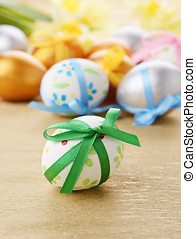 Easter eggs with flowers over golden background