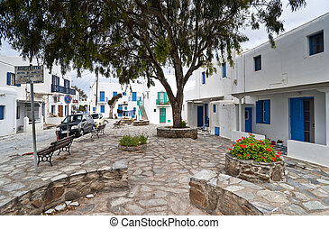 In Mykonos town - Mykonos street with external stairs of the...